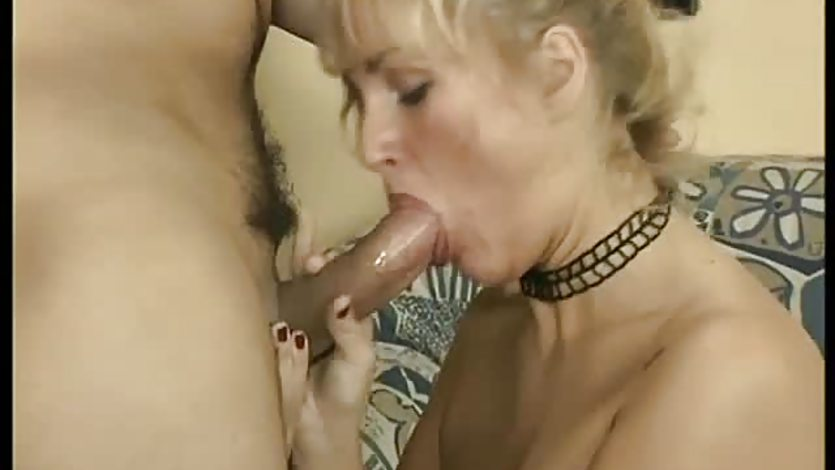 Mature blonde stuffs her mouth with cock