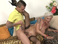 Tattooed busty granny gets laid | Big Boobs Update