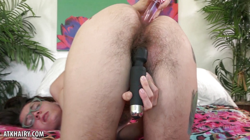 Bushy Valkyree Jaine fucks her ass with dildo