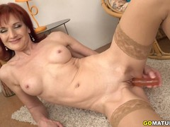 Naughty redhead mature Irena playing with herself