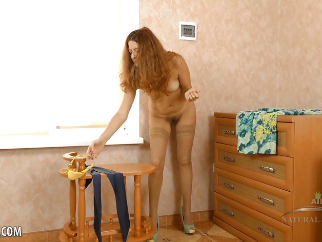 Helen Volga massages her hairy pussyhole with shoe